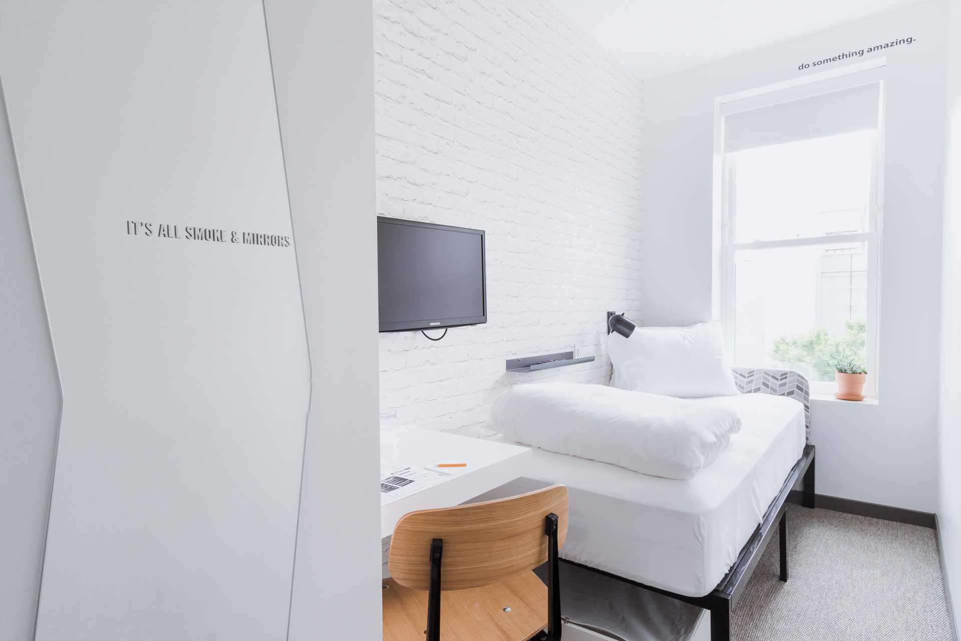 guest room with twin bed and desk