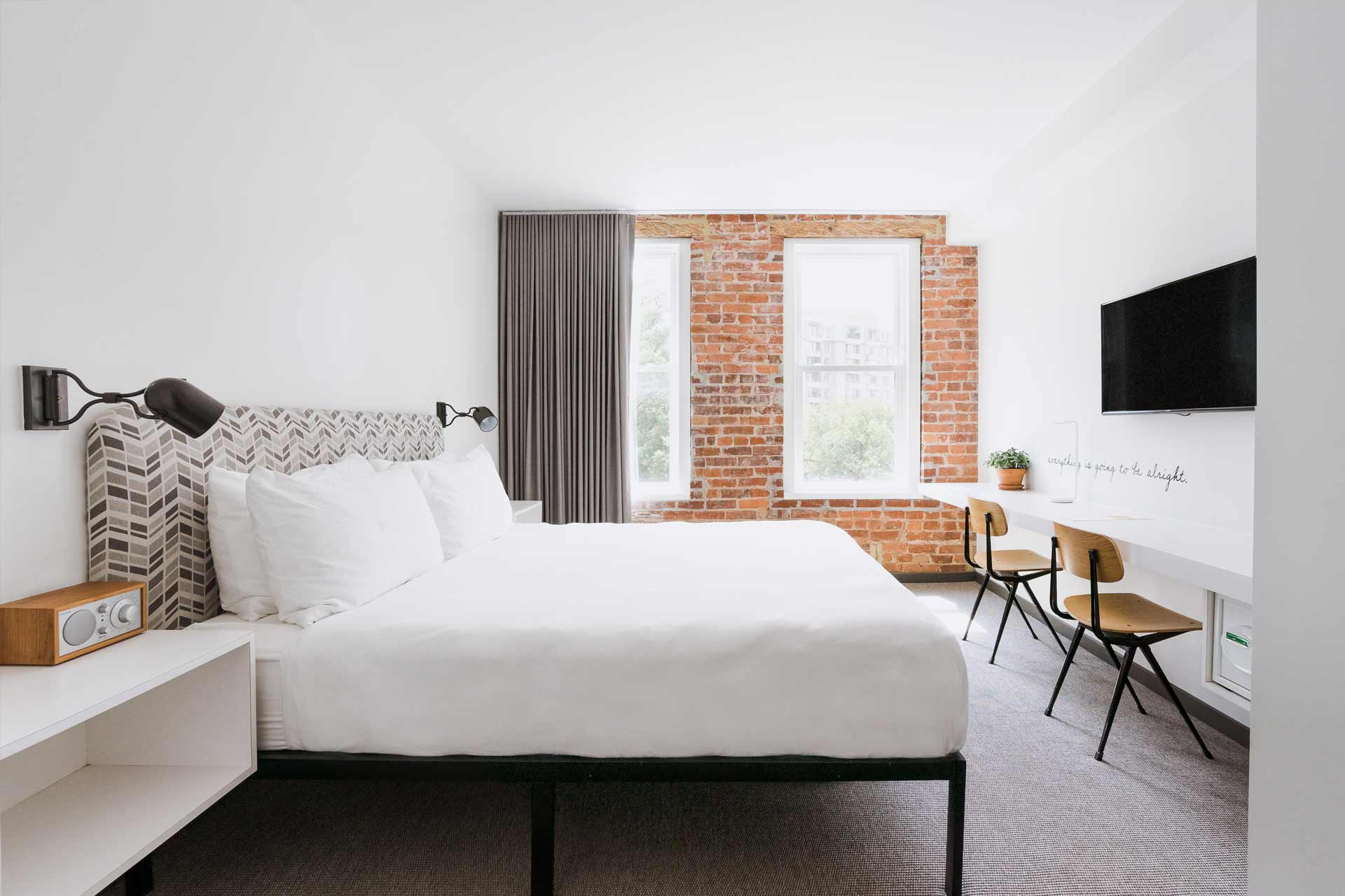 guest room with king bed and desk