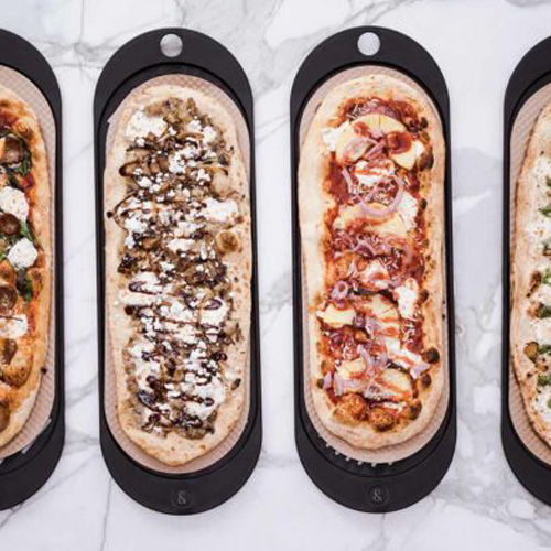 pizzas lined up on table
